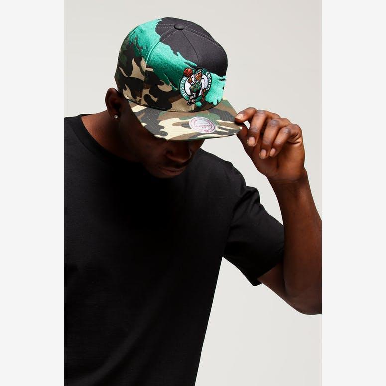 d8720452abc Mitchell   Ness Boston Celtics Camo Paintbrush Snapback Green Black ...