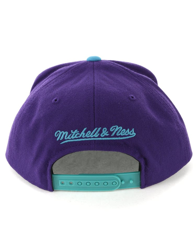 brand new ba308 ea118 Mitchell   Ness Charlotte Hornets Satin Fused Snapback Purple Teal